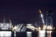 Nov. 6, 2012. The capsized cruise liner Costa Concordia is seen surrounded by cranes during a rescue operation in front of Giglio harbour, Italy.  [lightbox.time.com]