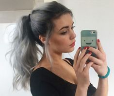 Silver grey hair and black roots