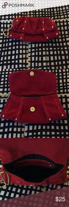 Red clutch with gold detail Red suede couch with with gold details           Worn once.                                                   Measurements 10x6 Bakers Bags Clutches & Wristlets