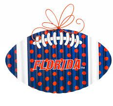 Made of durable indoor/outdoor printed corrugate metal, this team football door or wall hanger will make the perfect addition to your Gators décor. Dollar Store Crafts, Dollar Stores, Florida Gators Football, Florida Girl, Corrugated Metal, Coastal Homes, Home Decor Furniture, Wall Hanger, Christmas Ornaments