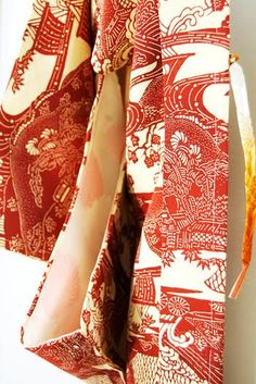 $65 - Vintage Japanese Silk Haori one-of-a-kind (1960s-70s) Decorated with an intricate scene of ships, waves representing strength, mountains and plum blossoms. In Japanese culture mountains depict sacred places between heaven and earth, and the plum blossom is believed to be a protective charm against evil. It also represents longevity, renewal and perseverance. The inner silk lining is beautifully decorated with chrysanthemums, which is a symbol of regal beauty, rejuvenation and…