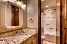 Beautiful bathroom with granite vanity counters