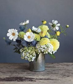 Finish by tucking in the cosmos (stems trimmed so the blossoms extend one to three inches above the dahlias).