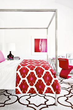 Tour a Gorgeously Layered, Artistic Hamptons Home// canopy bed, metal bed, red bedroom