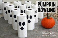 Halloween Games for Kids:  Pumpkin Bowling! Drop a small piece of candy inside each roll, children roll a pumpkin towards the pins and get to keep the candy inside the rolls they knock over.