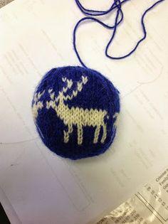 Knitted reindeer Christmas ball.