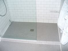 penny tile bathroom floor bathroom with glass wall gray floor