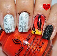 heartnat24: Catching Fire inspired nails Full post: here