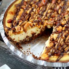 Chocolate Chip Quadruple Nut Crunch Cheesecake is made over a chocolate graham cracker crust and topped with caramel and chocolate drizzle!