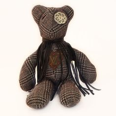 "Picone  by Tara Logsdon (""Meet Picone. Tara Logsdon of EKL bearmy rescued this sweet teddy bear, who was in grave need of physical and psychological repair, from a thrift store. After many long hours in the OR spent repairing dismembered appendages using hand-stitching techniques, the patient was given a new heart (to ease abandonment issues) and new eyes (for a new outlook on life). Now its mission in life is to combat mass production and consumption."")"