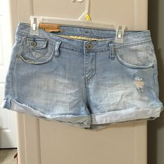 Piama jean shorts Juniors size 11 shorts. Light blue denim. Folds on the bottom. Cute pockets on the back. Oversized tag hangs over pocket on back. Piama Shorts Jean Shorts