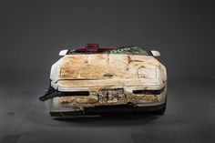 Craftspeople and technicians at the General Motors Design Center are painstakingly restoring the historic 1 millionth Chevrolet Corvette damaged nearly 16 months ago when a sinkhole opened beneath the National Corvette Museum in Bowling Green, Ky.   - PopularMechanics.com