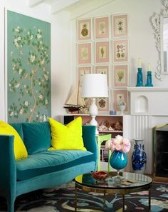 Love the turquoise sofa with the bright yellow pillows! Pale pink mats on the framed prints is a unique choice!