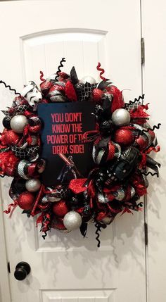 Enjoy your trip to the dark side of the force with this Star Wars deco mesh wreath complete with Darth Vader in this red and black colored wreath complete with Dark side sign,storm trooper, and lots of fun red and black ribbon and ornaments. Visit our facebook page. facebook.com/craftycrandallcreations
