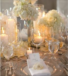 I want my tables to look like this. Love the champagne linens.