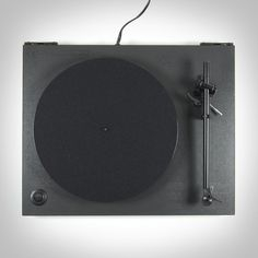 Ace x Rega RP1 Turntable. Product details including regulatory on top of product. Gloss black printed on matte black.