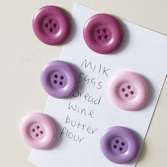 Super easy craft idea, turn buttons into magnets.