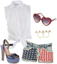Step out in Del Rey's signature all-American aesthetic with this patriotic ensemble. Wear a tie-front sleeveless button-up shirt with American flag denim shorts. Platform sandals, a stud ring, and heart-shaped sunglasses finish off the look.