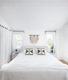 White bedroom in rustic modern farmhouse by Trinette Reed for Stocksy United