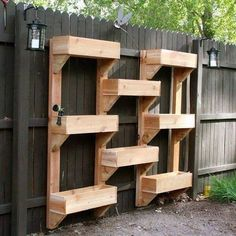 DIY Vertical Wooden Box Planter - This would be GREAT in my back yard, considering we have such limited space. Hope my hubby is excited to make it! :)