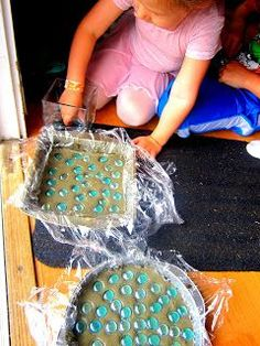 We did this with tiles. I love them in my flower bed. DIY STEPPING STONES -fun with kids!!!!