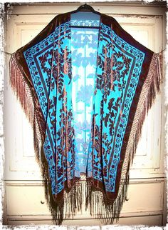 """Soooooooo GOOD! Awesome vintage inspired caftan! Great with anything and everything year round, truly a timeless piece! Gorgeous art deco floral pattern...back takes one shawl so there is no seam and the square shape creates a beautiful effortless drape.  Insanely gorgeous color combo in turquoise and rich brown simply to-die-for! Silk fishnet fringe goes all the way down the sides and along bottom creating incredible movement. Total length including fringe is 51""""One size..."""