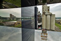 Mississippi Riverfront Reflected in Mirrored Windows on Endless Bridge at the Guthrie Theater, Minneapolis, MN