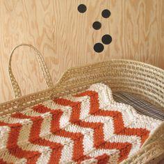 Knitted Chevron Baby blanket for Bassinet, Stroller, or Car Seat in Orange/Cream. $55.00, via Etsy.