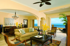 The Presidential Suite living room at the Secrets Capri Riviera Cancun.