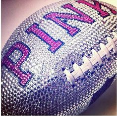 PINK Sparkles football!  I want this on a shelf im my house!  This is the bomb digety! <3