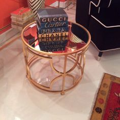 Drum shaped side table with brass finish and mirrored top brings sophisticated style.