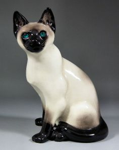 """A """"Winstanley"""" Kensington pottery Siamese cat with blue glass eyes 