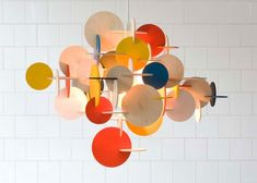 http://www.digsdigs.com/suspension-lamp-made-of-plywood-pieces-bau-pendant-by-normann-copenhagen/