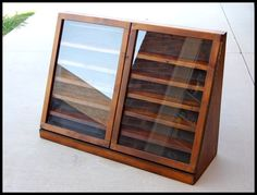 display case. cabinet: 41 W 29 H 14 D at base 3 D at top. Interior shelves: 2.75 D 5.75 H on top shelf 3.75 H on remaining shelves. piano hinged doors. (3 images.)                                                                                                                                                     More