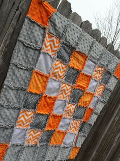 This gorgeous orange, gray & white Rag quilt is so classic looking ! The gray minky border with orange minky corners gives the quilt a finished touch! @ https://www.etsy.com/listing/190162819/orange-gray-white-chevron-and-polka-dot?ref=sr_gallery_15&ga_search_query=orange+and+gray+quilt&ga_search_type=all&ga_view_type=gallery&show_panel=true