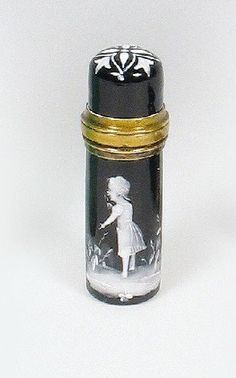 A MARY GREGORY ENAMELED SCENT BOTTLE, the black gl