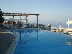 Sifnos, Greece -The left lounge chair was my favorite. Bella Vista Hotel, Greek Islands, Windmill, Greece, Hotels, Lounge, Exterior, Sea, Chair