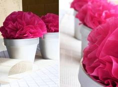 Tissue Flower Centerpieces -- simple/inexpensive clay pot, painted white, topped with simple/inexpensive tissue paper pom/flower. Fabulous! Also notice the table runner -- book pages... More fabulousness!!! ;o)