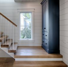 The foyer also features a brilliantly-designed custom blue cabinet that is perfect to hang coats and such. Paint color is Benjamin Moore CSP 600 Andes Summit.