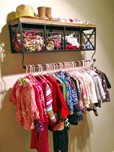 Hobby Lobby Shelf used as wardrobe closet for a nursery with no storage! This shelf has been SO versatile for us