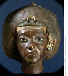 The head of Queen Tiye, wife of Amenophis III and mother of Akhenaten. Country of Origin: Egypt. Culture: Ancient Egyptian. Date/Period: 18th dynasty c.1403-1365BC. Material Size: Ebony, gesso & gold. Credit Line: Werner Forman Archive/ Egyptian Museum, Berlin . Location: 47.