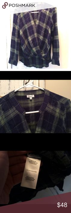 Splendid Plaid Surplice Top If you love flowy, drapey fabric, this Surplice top is a must-have for your romantic style. This is classic plaid has a flat collar, shirttail hem, and wrapped front design.  100% Rayon.  EUC. Splendid Tops