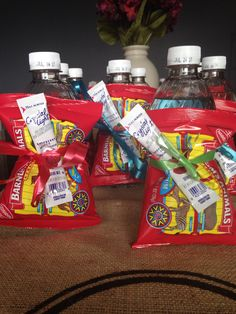 Party favors for a zoo party... Made these for my daughters party at our local zoo, small bottle of water, animal crackers pack, and drink mix pack tied with a ribbon. Will keep the guests hydrated and give them a little snack!