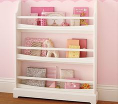 This could be an option for Mabel's books - maybe at the foot of her bed with a rocking chair and little baby doll bed by it.