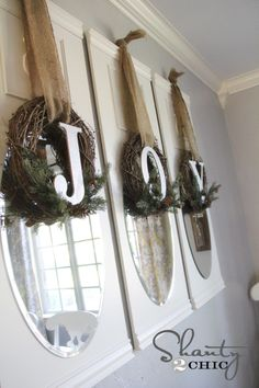 DIY Wreaths For Christmas - Love these! Hang 3 grapevine wreaths with evergreens and monogram accents, burlap ribbon!