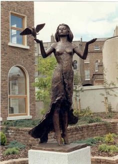 1990 An Spéirbhean - Girl with dove, life size bronze sculpture by Robin Buick for office development in Dublin City centre.