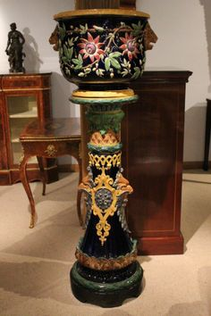 A highly decorative and imposing Victorian Period majolica jardiniere on stand. The jardiniere is in a Minton design, though perhaps manufactured elsewhere. Pedestal unknown.
