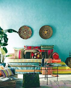 Lounge area with colorful pillows, art, and walls