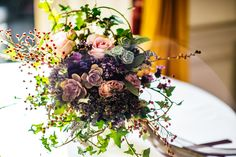 Keeping a wild and natural theme with home-grown wild flowers like mint, lavender, and berries to compliment the soft pink roses, succulents and ivy in this stunning bridal bouquet. Wedding Flower Arrangements, Wedding Flowers, Wedding Day, Pink Roses, Special Day, Wild Flowers, Succulents, Floral Wreath, Reception
