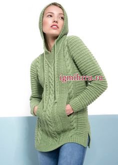 Sports theme. Light green pullover of relief patterns, with hood and pockets. Knitting
